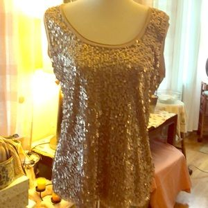Champagne color sequin tank size xl, stretches